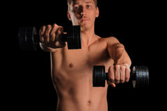 Man exercises with dumbbells Royalty Free Stock Photo
