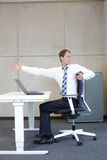 Man exercises in office Royalty Free Stock Images