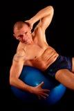 Man exercises on pilates ball Stock Image