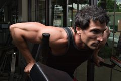 Man Exercising Arm Muscles stock image