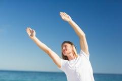 Man exercising on beach Stock Photography