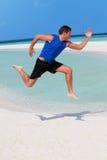 Man Exercising On Beautiful Beach Stock Image