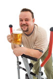 Man exercising with a beer royalty free stock images