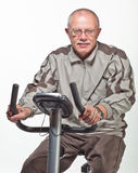 Man exercising on a bicycle trainer Royalty Free Stock Image