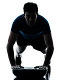 Man exercising bosu push ups workout fitness posture silhouette Royalty Free Stock Images