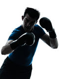 Man exercising boxing boxer posture silhouette Royalty Free Stock Images