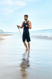 Man Exercising, Doing Fitness Exercises Outdoor On Beach. Sport Royalty Free Stock Photography