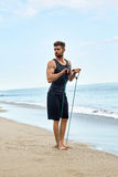 Man Exercising, Doing Fitness Exercises Outdoor On Beach. Sport Royalty Free Stock Photos