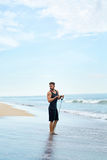 Man Exercising, Doing Fitness Exercises Outdoor On Beach. Sport Stock Image