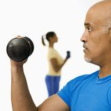 Man exercising with dumbbell. Royalty Free Stock Photography
