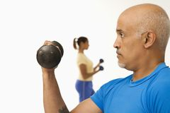 Man exercising with dumbbell. Stock Image