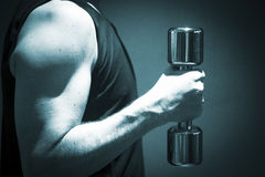 Man exercising with dumbbell gym weight health club Royalty Free Stock Photos