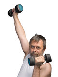 Man exercising with dumbbells Stock Image
