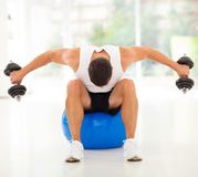 Man exercising dumbbells Stock Photography