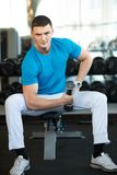 Man exercising with dumbbells Royalty Free Stock Images