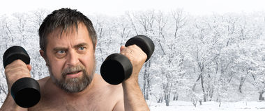 Man exercising with dumbbells Royalty Free Stock Photo