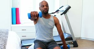 Man exercising with dumbbells 4k