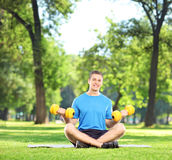 Man exercising with dumbbells in park Royalty Free Stock Photography