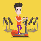 Man exercising on elliptical trainer. Royalty Free Stock Photos