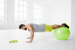Man exercising with fitball Stock Photos