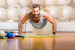 Man exercising with fitball Stock Photography
