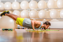 Man exercising with fitball Royalty Free Stock Photos