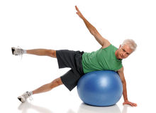 Man Exercising With Fitness Ball Stock Photo