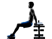 Man exercising fitness crunches Bench Press exercises silhouette Stock Images