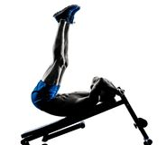 Man exercising fitness crunches Bench Press exercises silhouette Stock Photography