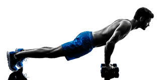 Man exercising fitness crunches silhouette Stock Photos