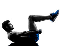 Man exercising fitness crunches weights exercises silhouette Royalty Free Stock Photo
