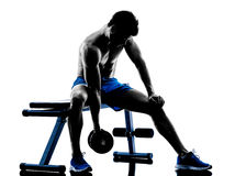 Man exercising fitness weights Bench Press exercises silhouette Royalty Free Stock Image