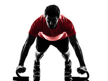 Man exercising fitness workout push ups  silhouette Stock Photos