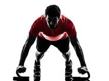 Man exercising fitness workout push ups silhouette. One man exercising fitness workout push ups in silhouette on white background stock photos