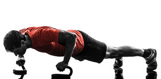 Man exercising fitness workout push ups  silhouette Royalty Free Stock Photography