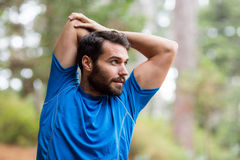 Man exercising in forest Royalty Free Stock Photos