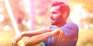 Man exercising in forest stock photography