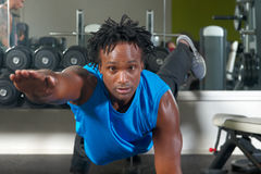 Man exercising in gym Stock Image