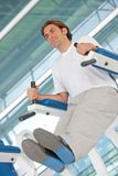 Man  exercising at the gym Stock Photos