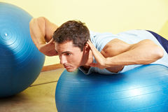 Man exercising on gym ball Royalty Free Stock Photography