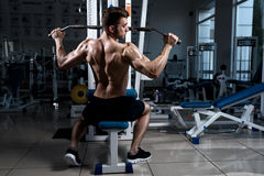 Man exercising at the gym on a machine Stock Image