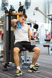 Man exercising on gym machine Stock Photos
