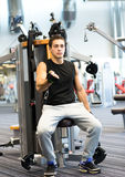 Man exercising on gym machine Stock Photo