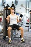 Man exercising on gym machine Royalty Free Stock Photo
