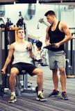 Man exercising on gym machine Stock Photos