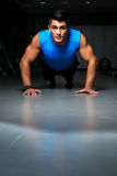 Man exercising in gym push ups Stock Photography