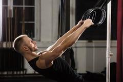 Man Exercising On Gymnastic Rings Stock Photos