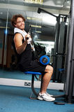 Man exercising with help of a hydraulic equipment Stock Photography