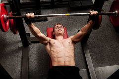 Man exercising his arm muscles Stock Photos