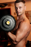 Man exercising his arm muscles Royalty Free Stock Photo